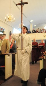 photo of Crucifer bringing forward the cross of Christ