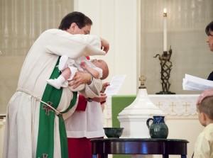 photo of pastor baptizing an infant