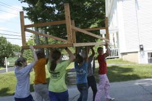 photo of youth mission workers carrying ramp platform