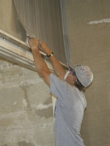 photo of youth mission worker removing wallpaper