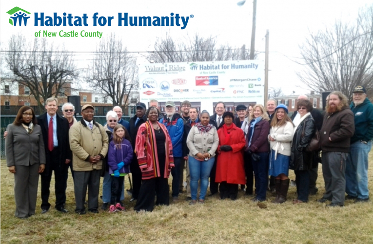 members join with Habitat for Humanity workers and home candidates for a groundbreaking